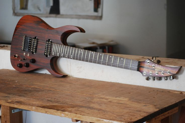 """Hermes by Distorted Branch Custom Guitars7 string guitarCocobolo top Mahogany and walnut backbolt-on Walnut Mahogany Purple Heart Wenge fingerboardBridge (piezo) and Tuners schaller Distotortion and Nazgul Seymour DuncanFlagship pre amp 3 way switch per pickup 26.5"""" scale16 radius24 Frets Satin"""