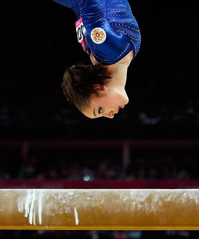 The expression on the face of Russia's Aliya Mustafina looks like she's only just realised the beam she's about to land on is only four inches wide