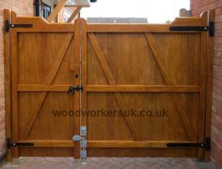 an unequally split pair of our Nannerch driveway gates - ideal if you've a large opening to fill but mainly want pedestrian access