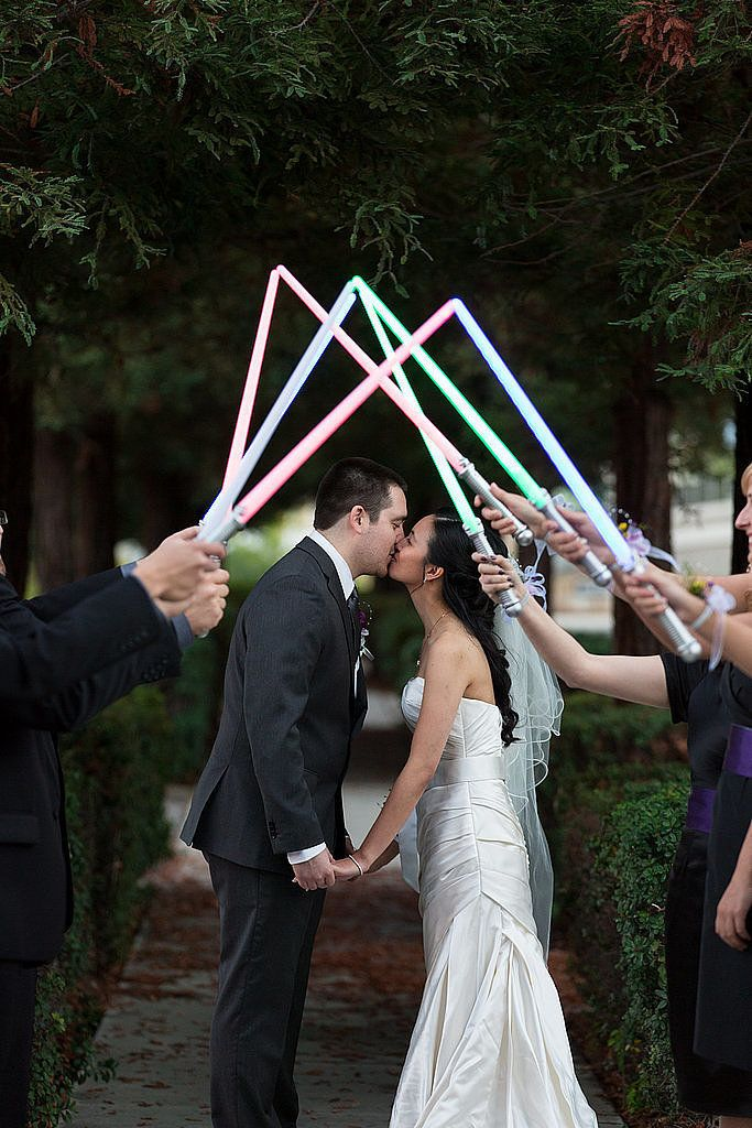 What would a Star Wars-themed wedding be without a lightsaber send-off?