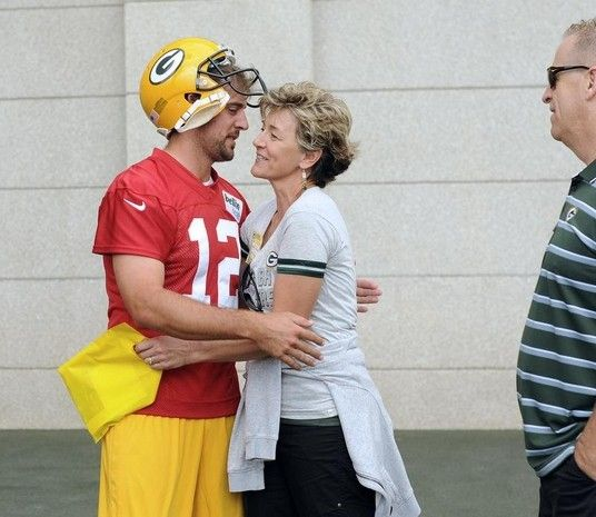 Green Bay Packers quarterback Aaron Rodgers hugs his mother Darla Rodgers before taking the field during training camp practice at Ray Nitschke Field on Friday, July 26, 2013. Also shown is Rodgers' father Ed. Evan Siegle/Press-Gazette Media