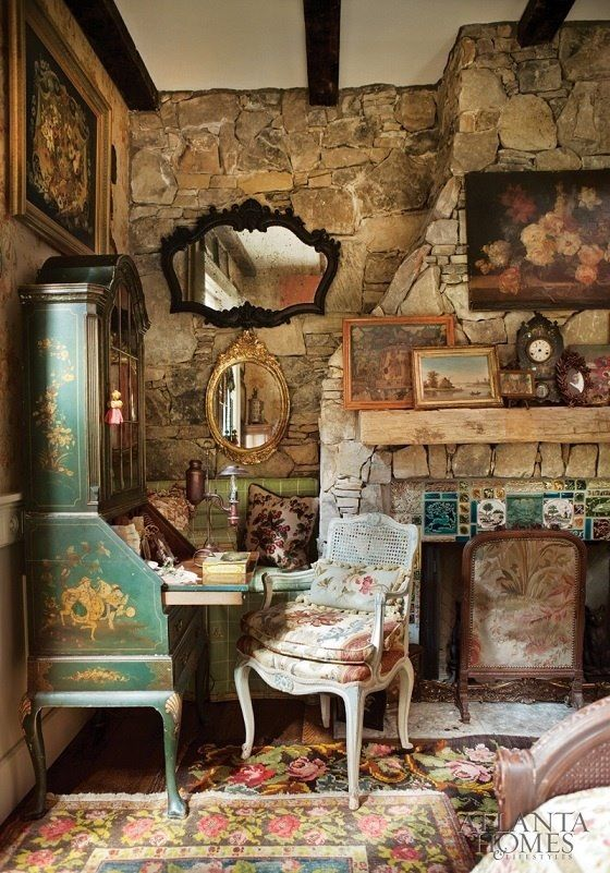 Love this rustic style, stone walls/fireplace, antiques, layered rugs