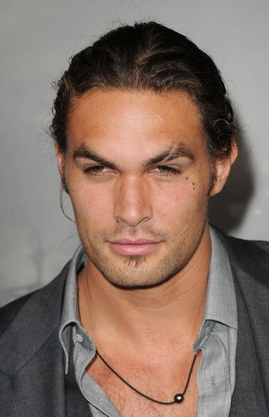 """Jason Momoa Photos Photos - Actor Jason Momoa attends the world premiere of 'Conan The Barbarian' held at Regal Cinemas L.A. Live on August 11, 2011 in Los Angeles, California. - Premiere Of Lionsgate Films' """"Conan The Barbarian"""" - Arrivals"""