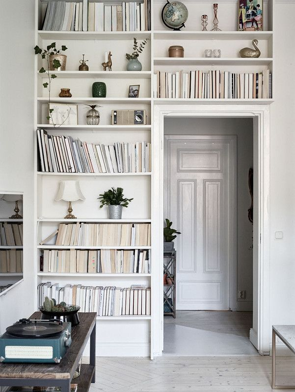 shelves over / around a doorway