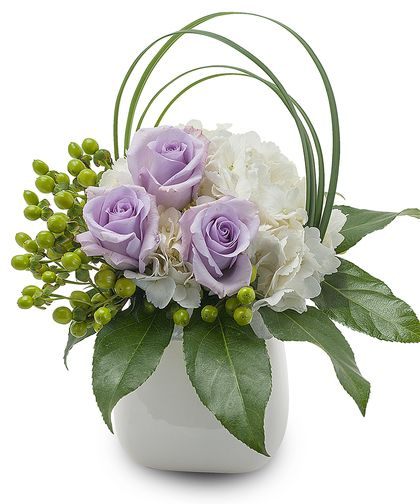 Bailey-Lovely lavender Roses and white Hydrangea, accented with a bear grass loop. #TheFlowerBucket #SanAntonioFlowers #MothersDay #MothersDayFlowers