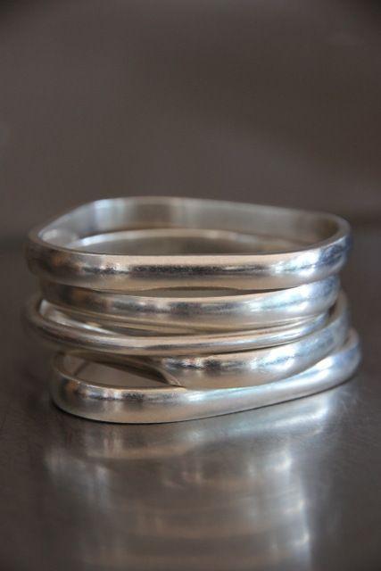 Stack of Dinosaur Designs silver bangles