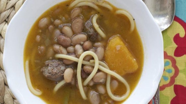 """This very traditional dish is typically served during winter in Chile. Made with a base of spaghetti and beans, its name- porotos con riendas or """"beans with reins""""-comes from the resemblance of the pasta to the 'reins' of a horse. For this recipe you can use pinto beans, which makes this a true comfort-food dish."""