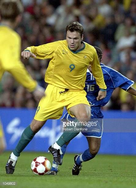 Mark Viduka of Australia slips past the Honduras defence during the Group A Men's Football match between Australia and Honduras on Day Four of the...