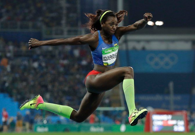Colombia's gold medal winner Caterine Ibarguen competes during the women's…
