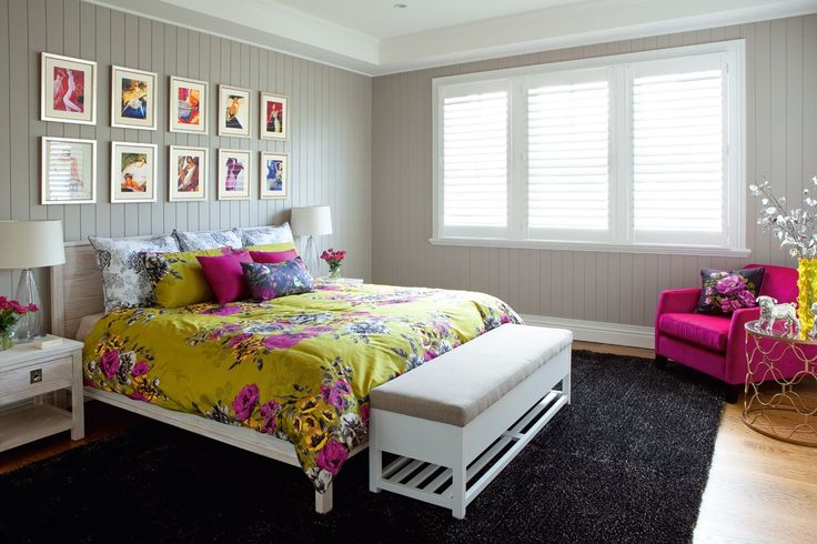 Guest Bedroom featuring a charcoal shag rug, bedding in fuchsia and chartreuse and framed artworks.