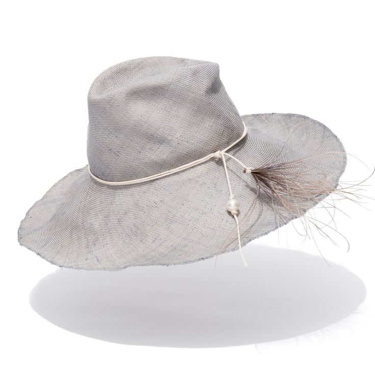 A special vintage straw hand dyed and shaped, with a reef inspired trim made from feathers and a Swarovski pearl   Especially hand crafted for Hamilton Island, also available at qualia boutique. Available in Grey or Cream SHOP NOW very limited supply of this vintage straw #sunhat #luxuryhat #hamiltonisland #qualia #luxurysunhat #hatmaker #jonathanhoward www.hatmaker.com.au