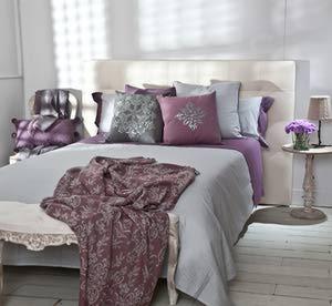 Textiles sofisticados para el dormitorio. Foto © Textura Interiors