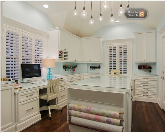 Great craft room! Could have a large table on the other side of the room, and fans on either side of the hanging lights.