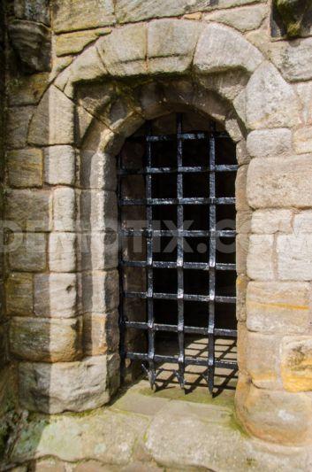 A portcullis at Stirling Castle in Scotland. A portcullis ...