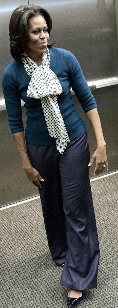 Fitted jumper with big neck bow to draw the eye up, wide leg pants in dark colour to skim over hips.