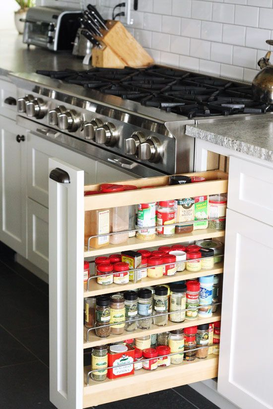 white kitchen stainless steel range spice cupboard