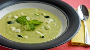 NYT carrot, zucchini and cucumber soup  2 tablespoons butter  2 onions, chopped (2 cups)  1 tablespoon chopped garlic  2 zucchini, cut into half-rounds (2 cups)  2 cucumbers, peeled, cored and sliced  3 carrots, scraped and sliced (2 cups)  1 tablespoon curry powder  6 cups canned chicken broth  1 cup heavy cream