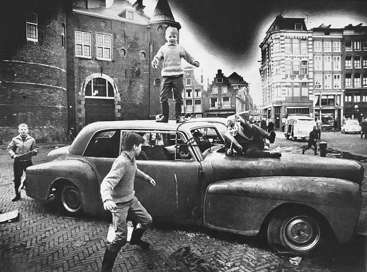 Ed van der Elsken. Children playing on abandoned car. Nieuwmarkt, Amsterdam. 1956