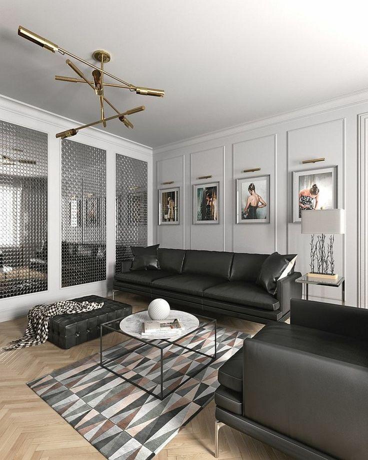 sofá de cuero negro grande en el salón con diseño escandinavo