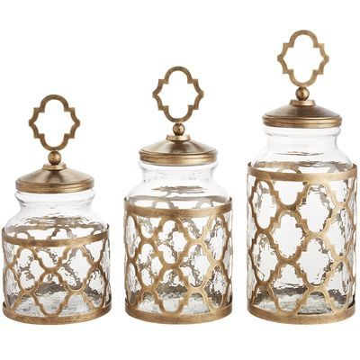 Our hammered glass canisters, framed and topped in antique gold-painted metal, will strike an elegant pose on your kitchen counter. But these pretty containers do more than vogue. With their easy-to-grab tops and wide mouths, they'll make your cooking tasks easier. Don't you just love pretty with a purpose?