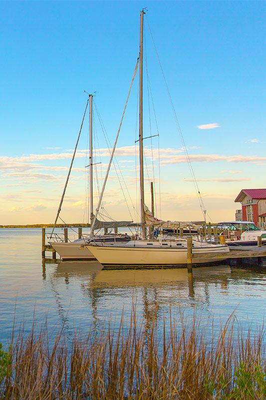 Skip the touristy destinations this summer in favor of quiet, small beach towns, where you'll find everything from lobster shacks to cheeseburger festivals.