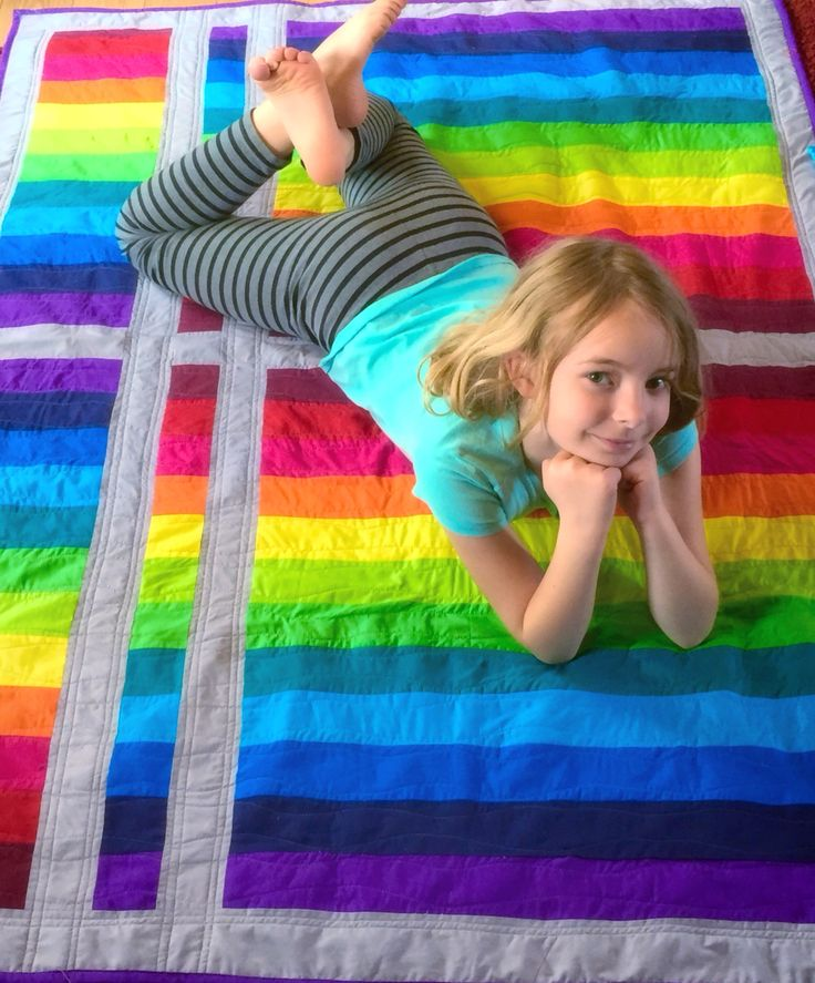 Twin sized rainbow strip quilt