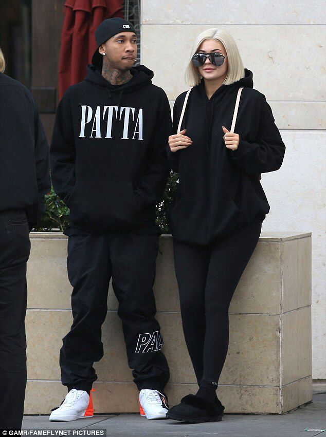 Kylie Jenner and Tyga lounge against Beverly Hills street planter #dailymail
