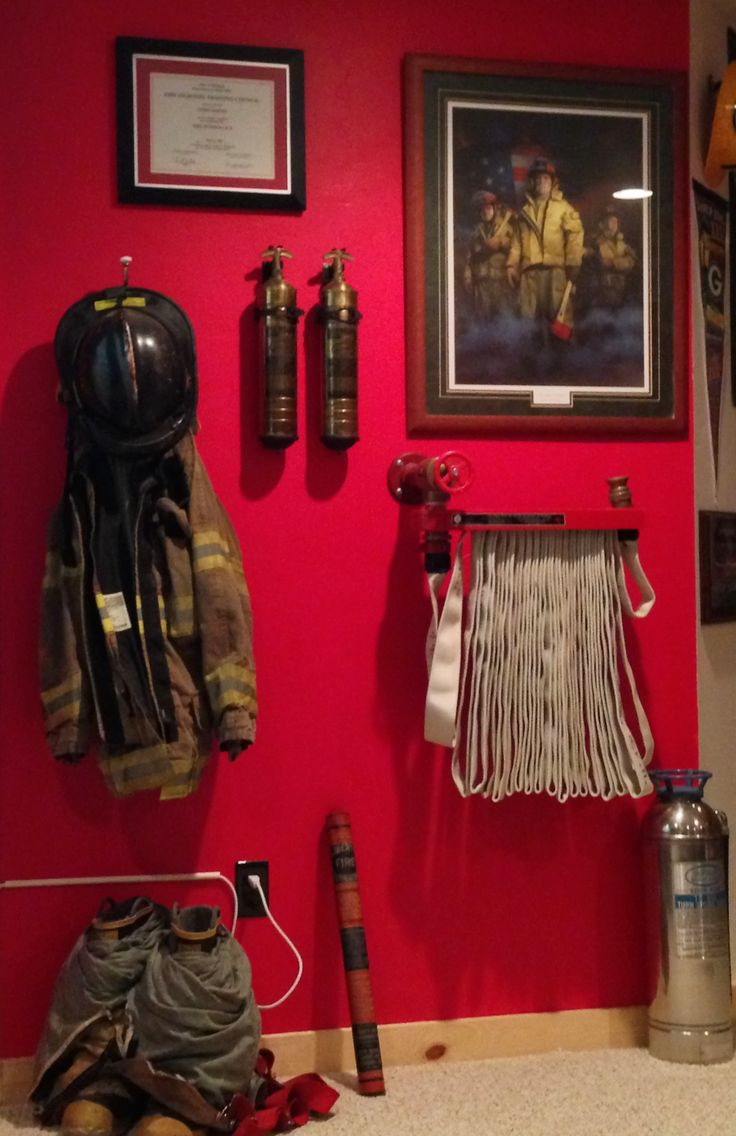 My hubby's firefighter wall in his man cave: an homage to his profession. All these items were from an old tavern that closed and garage sales More