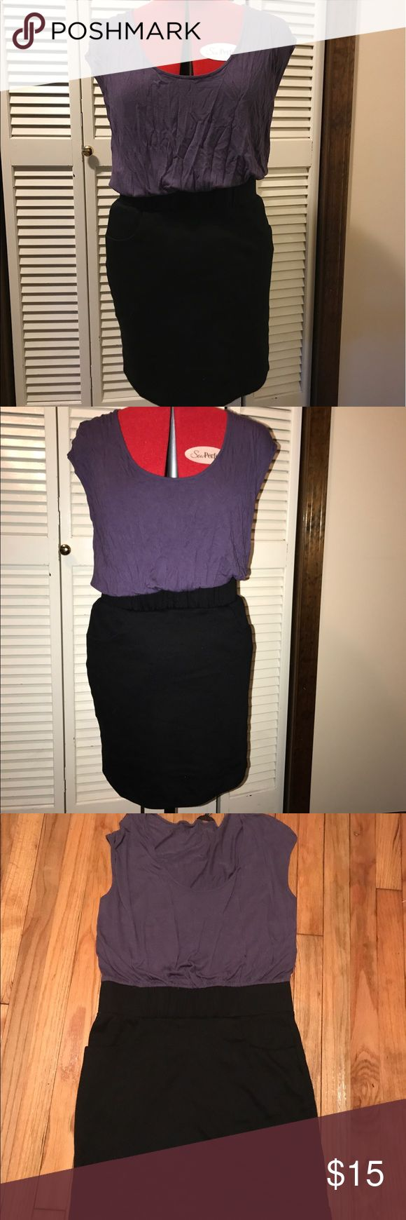 BLACK AND PURPLE DRESS A black skirt with a blousie purple top that are connected. It's got pockets!! The skirt isn't too tight but lays nicely and the purple is a thin fabric that doesn't hug. Daisy Fuentes Dresses