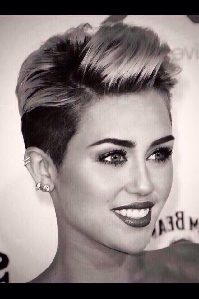 I want two cartilage piercings like Miley! Getting them soon:)