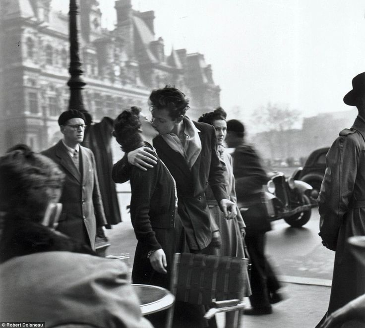 Robert Doisneau's Le baiser de l'hotel de ville (Kiss by the Hotel de Ville), which shows a young couple kissing amid the hustle and bustle of a Paris street. The picture typifies the romance of the French capital and went on to become his most famous shot. It has now been recreated in a Google Doodle