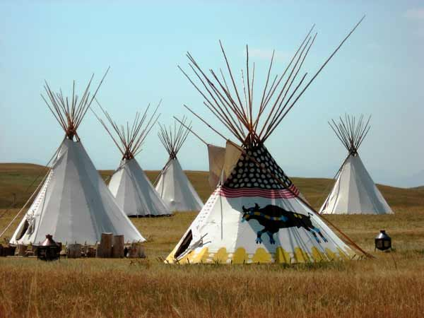 Tepees at Head Smashed in Buffalo Jump World Heritage Site at Fort Macleod, Alberta, Canada at a location where the foothills of the Rocky Mountains meet the Great Plains, one of the world's oldest, largest, and best preserved buffalo jumps can be found. Head-Smashed-In - a UNESCO World Heritage Site - has been used continuously by aboriginal peoples of the plains nearly 6,000 years.