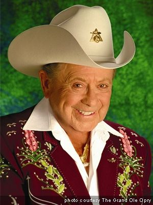 """2 January 2015 - James Cecil Dickens ( 1920 – January 2, 2015), better known as Little Jimmy Dickens, was an American country music singer famous for his humorous novelty songs, his small size, 4'11"""", & his rhinestone-studded outfits. He started as a member of the Grand Ole Opry in 1948 & became a member of the Country Music Hall of Fame in 1983. Toward the end of his life, Dickens made appearances in a number of music videos by fellow country musician & West Virginia native Brad Paisley."""