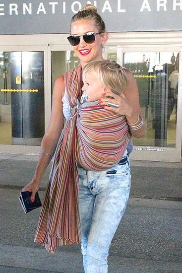 Kate Hudson. you go girl! Proper babywearing with a ring sling and a bigger kid.