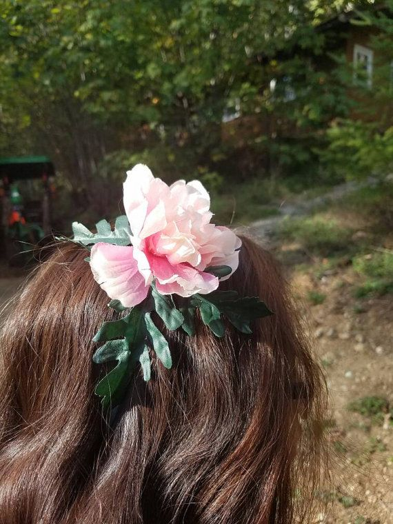 This headband, made of recycled vinyl flowers, was inspired by the pokemon Ivysaur. https://www.etsy.com/listing/483966465/vinyl-flower-headband-recycled-nature