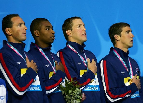 Michael Phelps Photos Photos - Gold medallists Michael Phelps, Cullen Jones, Neil Walker and Jason Lezak sing the national anthem of the United States of America following for the Men's 4x100m Freestyle Relay final during the XII FINA World Championships at the Rod Laver Arena on March 25, 2007 in Melbourne, Australia. - XII FINA World Championships - Day 9
