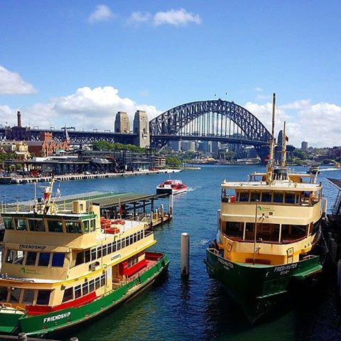 Sydney Ferry moored at Circular Quay Wharf in Sydney, Australia v@e