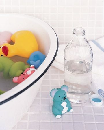 This tip from Martha Stewart removes that stinky mildew smell (I didnt cut open any plastics to check their sure-to-be fresh insides, though): Clean Bath Toys: Clean bacteria and mildew from bath toys by giving them a vinegar-water bath. Fill a bucket or large bowl with warm water, adding 1/2 cup white vinegar per gallon of water. Soak toys for 10 minutes, then rub gently with a sponge and allow to dry. The acetic acid in vinegar cuts through dirt buildup and works as a natural disinfectan