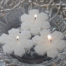 12 mini snowflake floating candles. Dinner party wedding reception table centerpiece décor. $8.00, via Etsy.