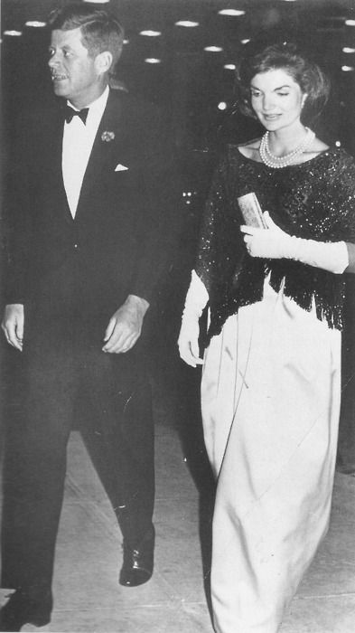 President and Mrs. Kennedy at a dinner in honor of the second anniversary of his inauguration.