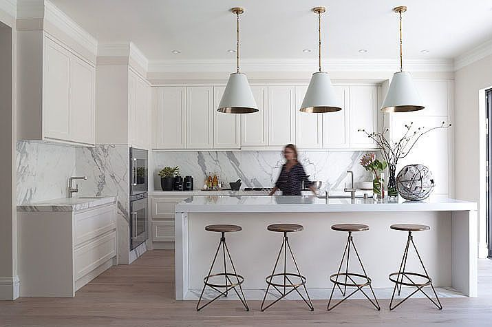 ional chef's kitchen, but also, white makes just as much of an impact as a bright color. It's no surprise the marble countertops are the ma