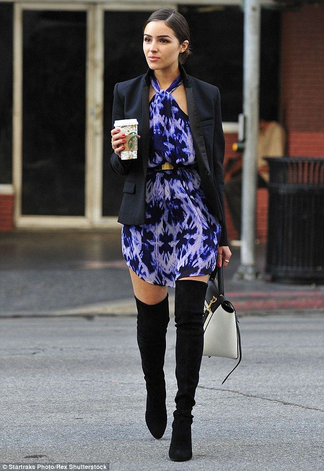 Fashion forward: Olivia Culpo looked ready for a photoshoot while out and about New York City on Monday, wearing a patterned purple dress, with a gold buckled belt to cinch her waist