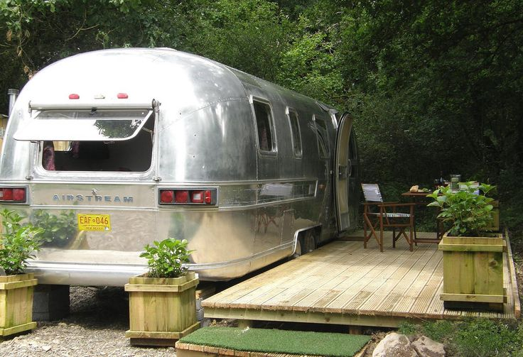 https://flic.kr/p/bTjSbZ | Retro Amercian Airstream caravan, Carmarthenshire, West Wales, 2011 | This 31ft 1976 vintage American airstream caravan has been totally refurbished and is available to rent by the week and for short breaks.  It is sited in it`s own lovely private dingly dell in Ty Cefn Tregib, Ffairfach which is near the town of Llandeilo in Carmarthenshire. It provides a comfortable holiday home for 2 people, with a distinctly retro seventies feel. The end nearest the door is a…