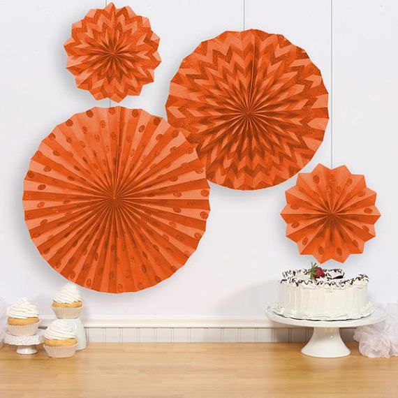 Orange Glitter Polka Dot & Chevron Paper Fan Decorations add a fun and trendy touch to your party. These paper fans feature glitter polka dots & chevron patterns. Set includes a large paper fan with glittery polka dots, a medium paper fan with glittery chevron, and two small paper fans — one with polka dots and one with chevron. Glitter Orange Polka Dot & Chevron Paper Fan Decorations product details: 4 per package Large decoration, 16in diameter Medium decoration, 12in diame...