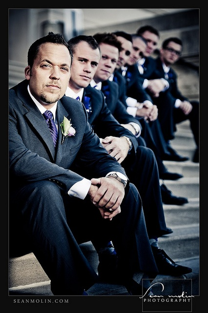 groomsmen. Like how they have (I'm guessing) the groom  up front and it blurs the rest of the men into the background.