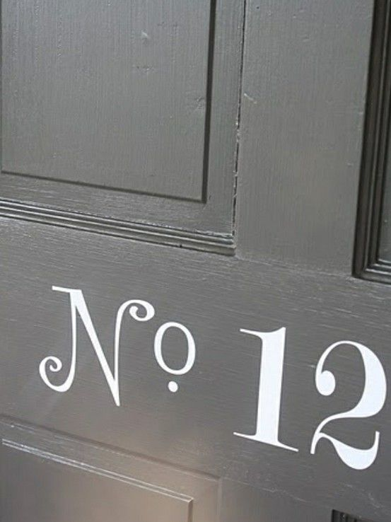 Painted numbers on a black door. so classic