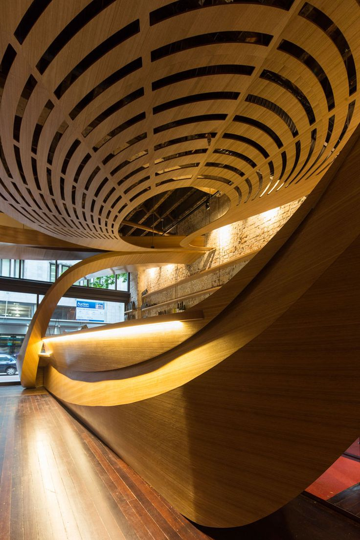 This new cafe is filled with a sculptural wood feature inspired by coffee swirl patterns