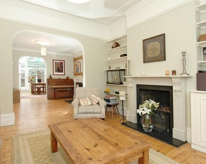 Photo Of Airy Simple Beige Cream Dining Room Lounge With Archway Fireplace Open Fire Wooden Flooring