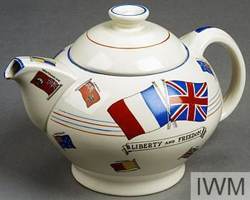 "Crown Ducal ""WAR AGAINST HITLERISM"" WWII patriotic teapot decorated with patriotic slogans and flags of British allies 'This Souvenir teapot was made for Dyson & Horsfall of Preston to replace Aluminium Stocks taken over for Allied Armaments"", ""THAT RIGHT SHALL PREVAIL"" and ""LIBERTY AND FREEDOM"", 1939, earthenware, Richardson and Co Ltd, Tunstall and Cobridge, Stoke-on-Trent, UK / Imperial War Museum, UK"