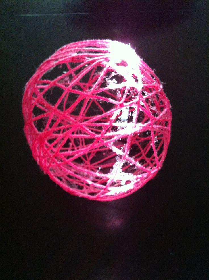 Yarn Globe made from yarn, modge podge, and balloons.
